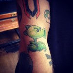 John Doe's Plants vs Zombies: Peashooter, by Spider Chong at Atomic Tattoos Austin tx